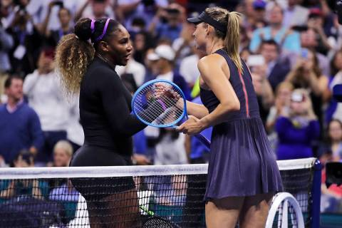 Serena Williams, left, shakes hands with Maria Sharapova after their first-round match at the U ...