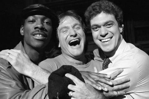 Robin Williams, center, takes time out from rehearsal at NBC's Saturday Night Live with cast me ...