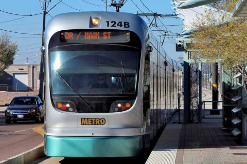FILE - In this Jan. 16, 2016 file photo, a Metro Light Rail train stops for passengers in Phoen ...