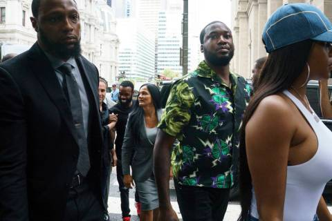 Rapper Meek Mill, center, arrives at the Criminal Justice Center in Philadelphia on Tuesday, Au ...