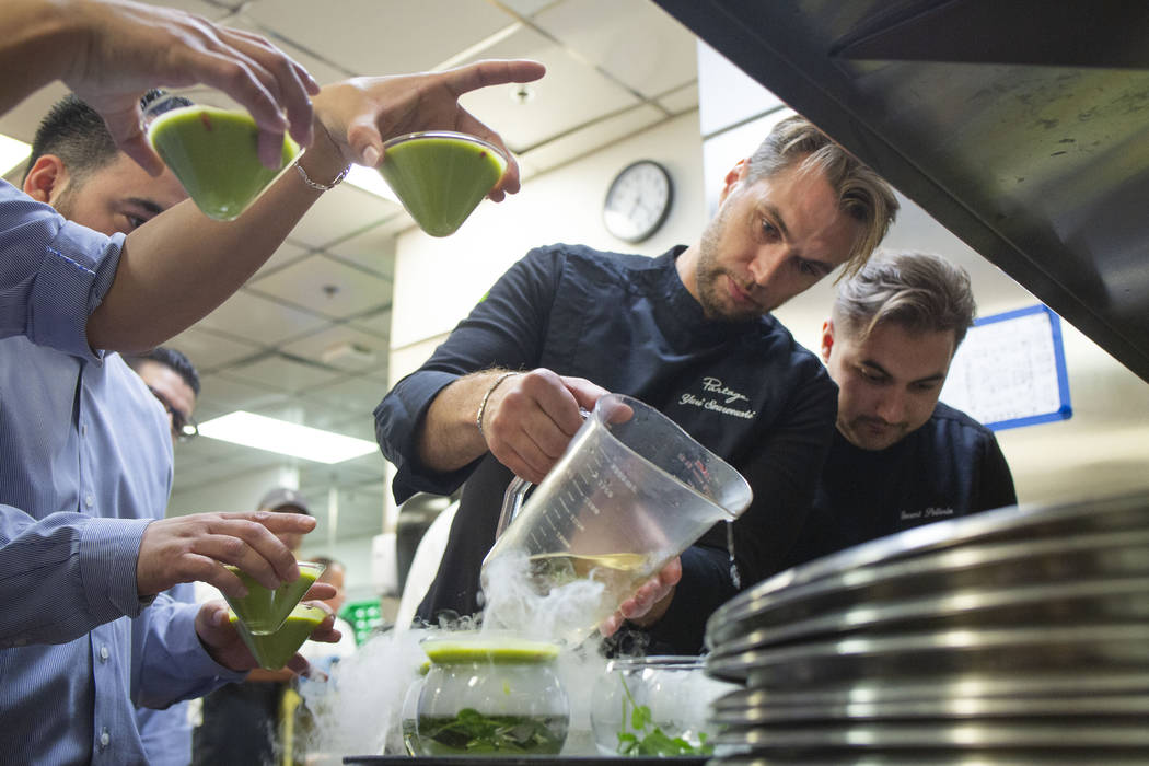 Chef Yuri Szarzewski of EATT Groumet Bistro, left, and chef Vincent Pellerin of Partage, prepar ...
