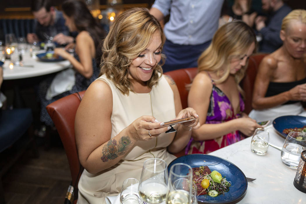 Founder of the blog Vegans, Baby, Diana Edelman takes photos of her dish during the recreation ...