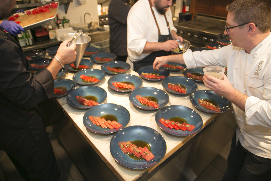 Photo by Rinah Oh Andrew Carroll, front, prepares Compressed Watermelon at the James Beard Hous ...