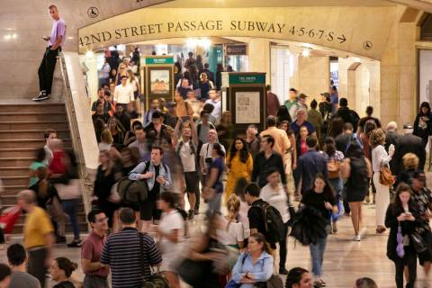 In this Aug. 23, 2019, photo, people pass through New York's Grand Central Terminal. With just ...