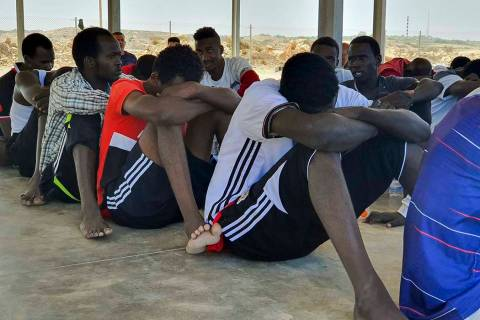 Rescued migrants rest near the city of Khoms, about 75 miles east of Tripoli, Libya., Tuesday, ...