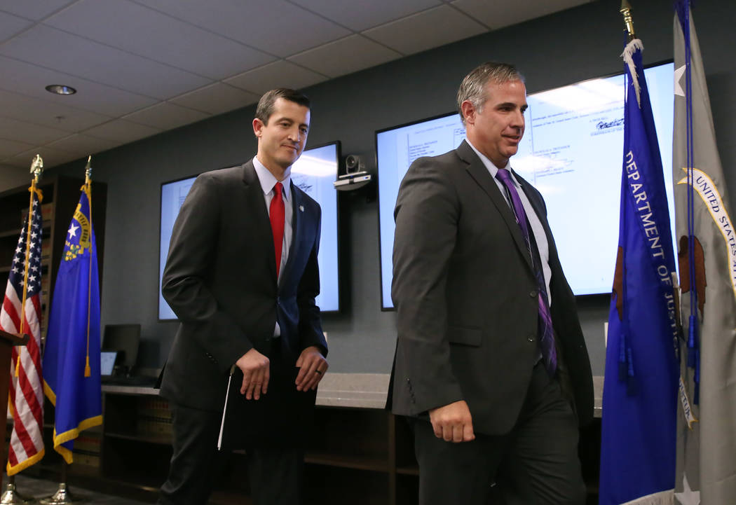 Nevada US Attorney Nicholas Trutanich, left, and Ray Johnson, assistant special agent in charge ...