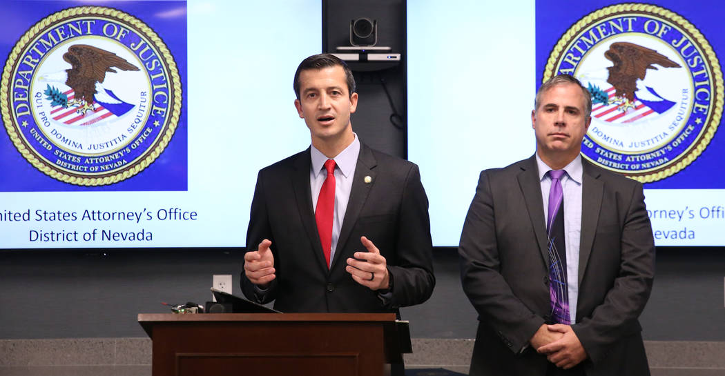 Ray Johnson, right, assistant special agent in charge of the FBI Las Vegas office, listens as N ...