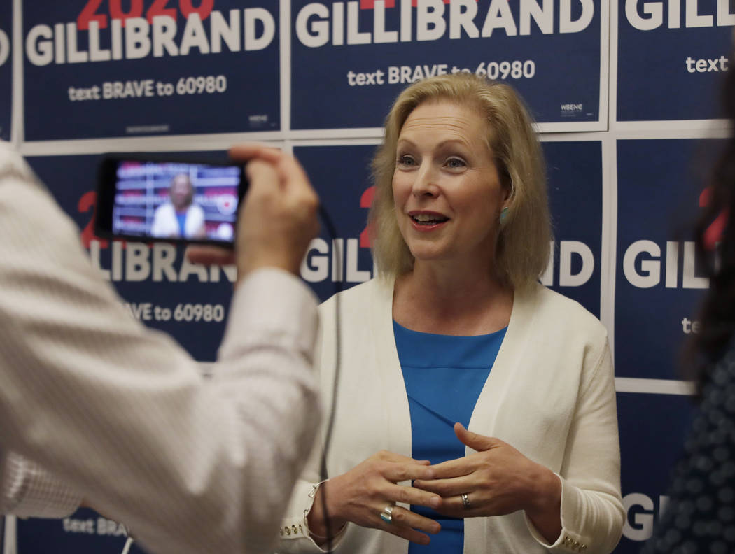 Democratic presidential candidate Sen. Kirsten Gillibrand, D-N.Y., speaks to a reporter after a ...