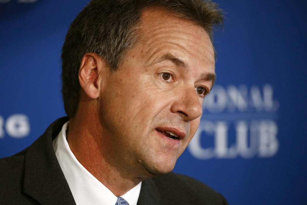 FILE - In this Aug. 7, 2019 file photo, Democratic presidential candidate Montana Gov. Steve Bu ...