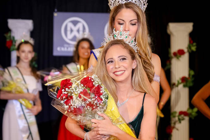 Kyndall Garza receives the crown for Miss World America - Nevada 2019 from Marisa Paige Butler, ...