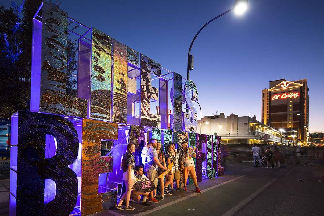 Festivalgoers pose next to a Life is Beautiful sign at the annual festival in downtown Las Vega ...