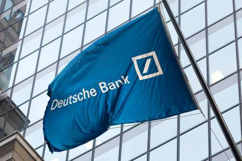 FILE - In this Oct. 7, 2016, file photo a flag for Deutsche Bank flies outside the German bank' ...