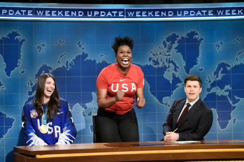 This March 3, 2018 photo released by NBC shows Leslie Jones, center, flanked by Ice Hockey Olym ...