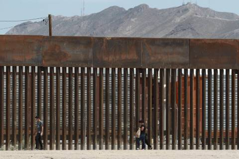 FILE - In this July 17, 2019, file photo, three migrants who had managed to evade the Mexican N ...