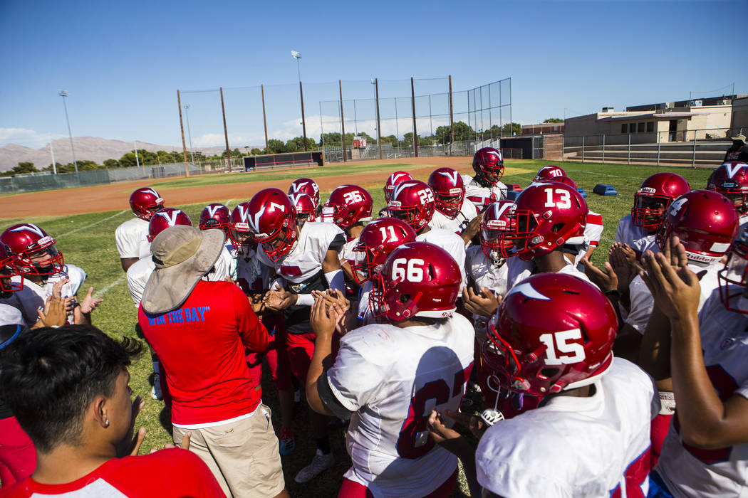 Valley coach Quincy Burts, left, leads football practice at the baseball field at Valley High S ...
