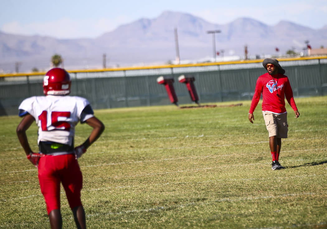 Valley coach Quincy Burts, right, leads football practice at the baseball field at Valley High ...