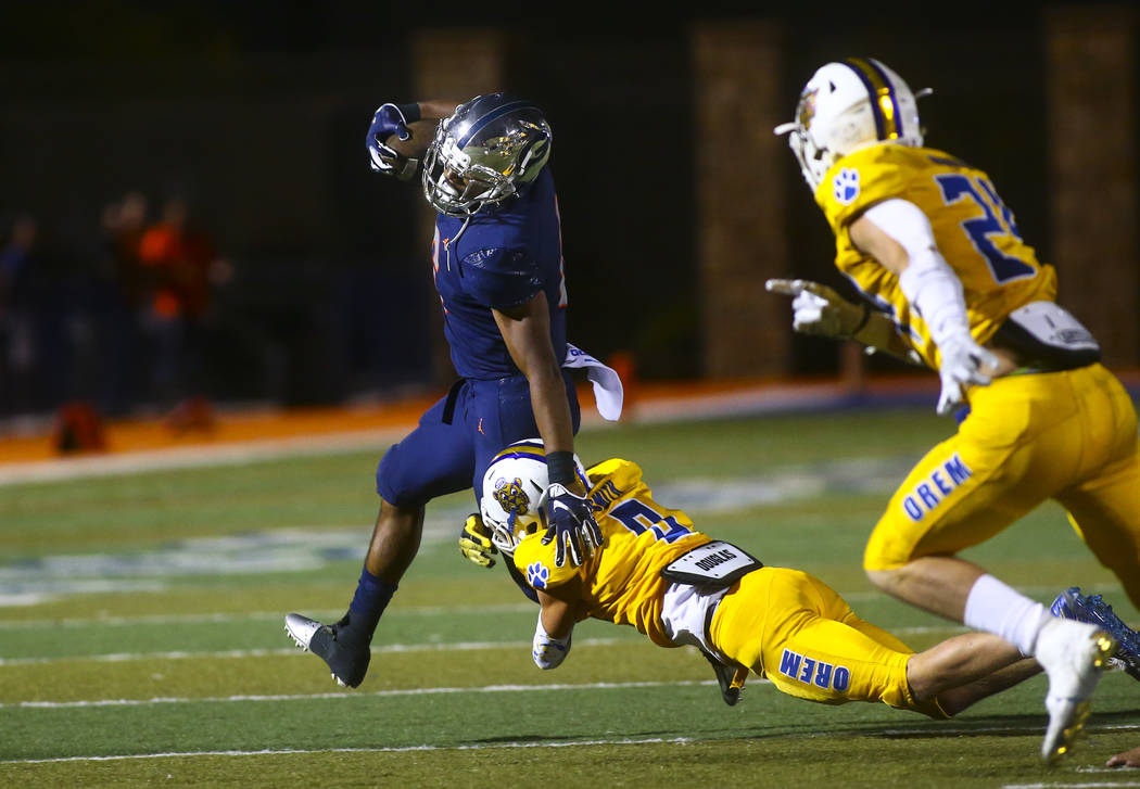 Bishop Gorman's Ikaika Ragsdale is stopped by Orem's Joe Smith (9) during the second half of a ...