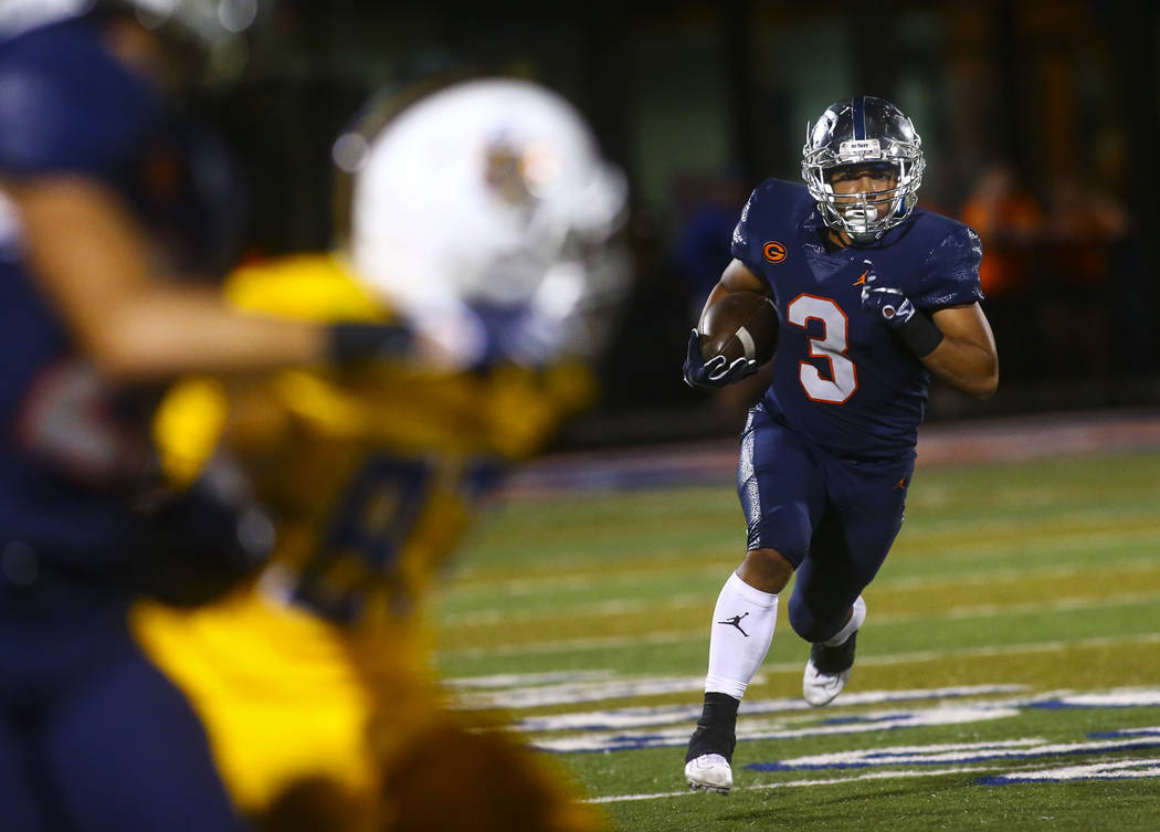 Bishop Gorman's running back Cam Barfield runs the ball against Orem during the second half of ...
