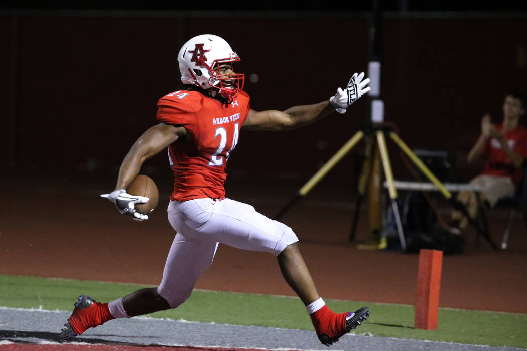 Arbor View's Daniel Mitchell (24) celebrates his touchdown run against American Fork in the sec ...