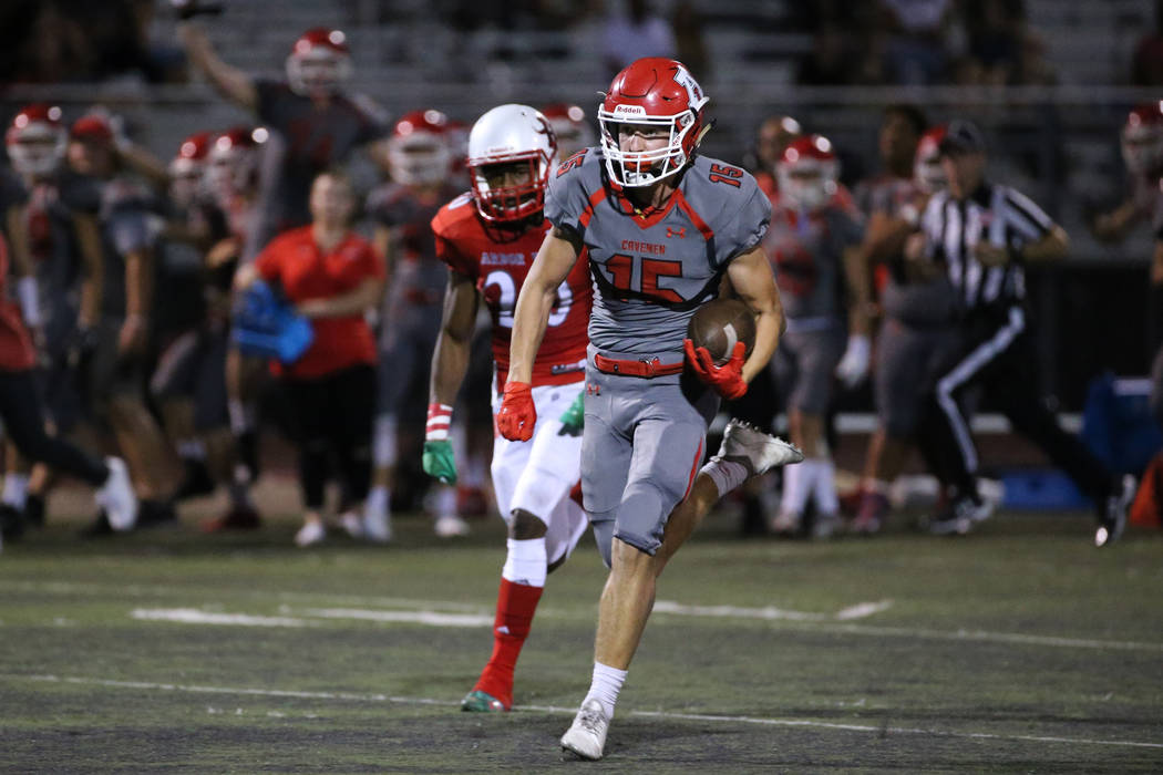 American Fork's Devin Downing (15) runs for a touchdown with Arbor View's Rickie Davis (20) fol ...