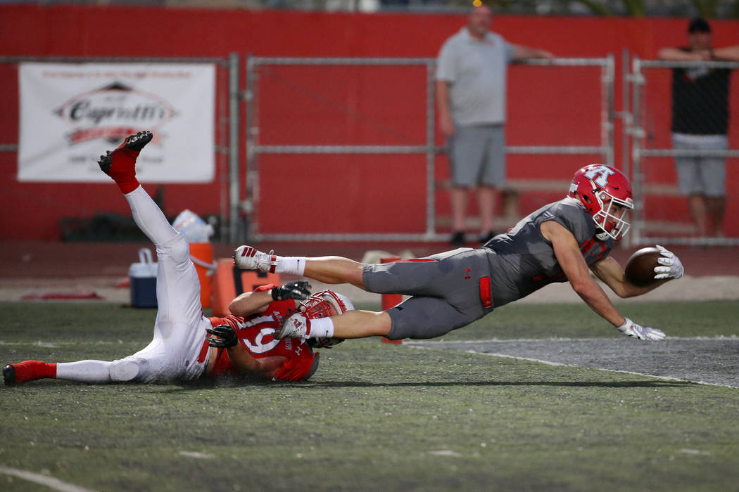 American Fork's Tanner Holden (11) dives for a touchdown against Arbor View's Nolan Weir (19) i ...