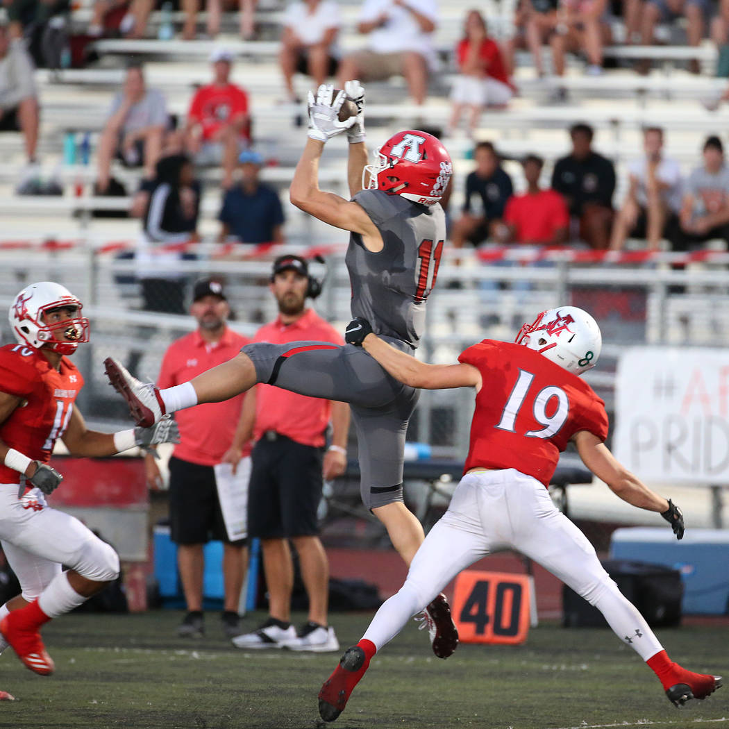 American Fork's Tanner Holden (11) makes a catch under pressure from Arbor View's Devin Ramirez ...