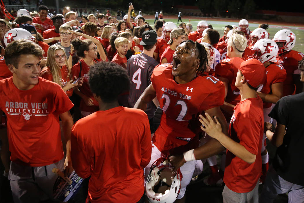 Arbor View's Zavier Alston (22) celebrates a win against American Fork in the football game at ...