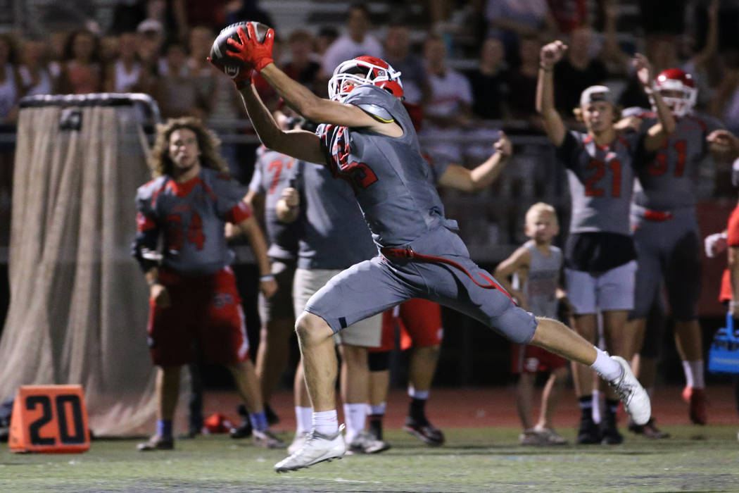 American Fork's Devin Downing (15) makes a catch before running for a touchdown in the fourth q ...