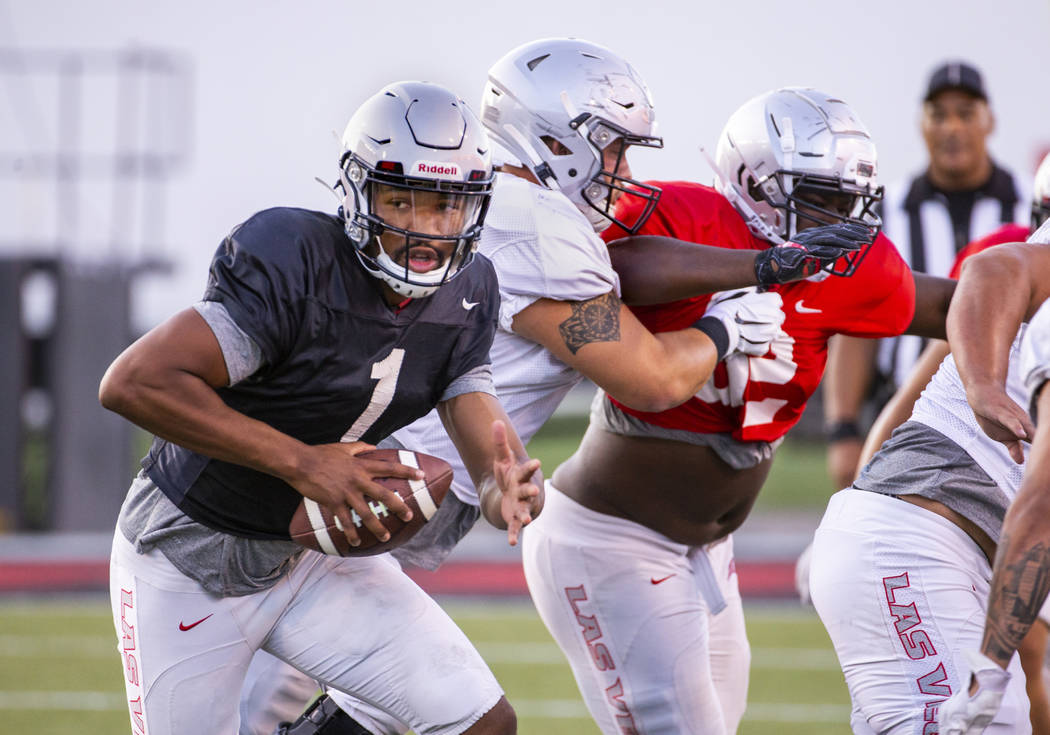 UNLV QB Armani Rogers (1) looks for room to run during their first major scrimmage of football ...