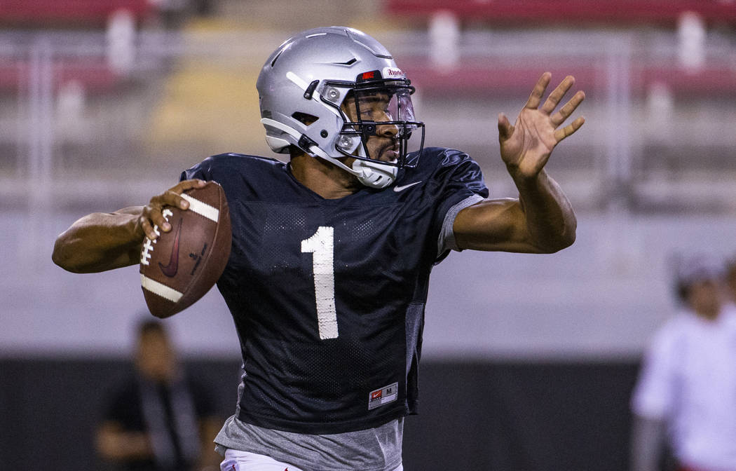 UNLV QB Armani Rogers (1) eyes an open receiver during their first major scrimmage of football ...