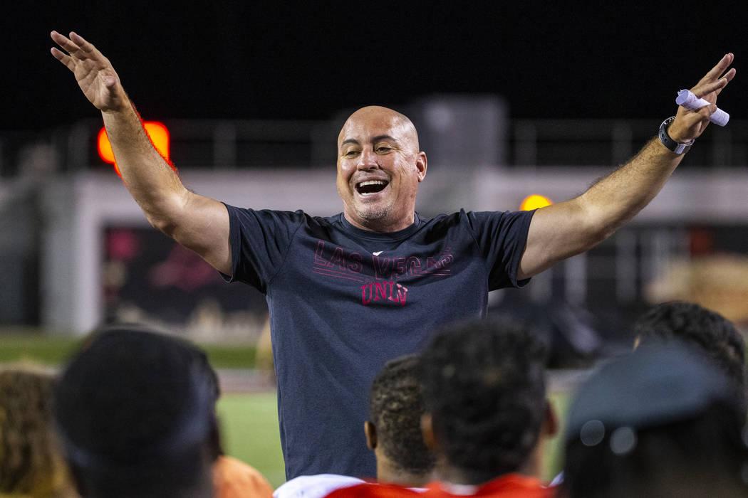 Head coach Tony Sanchez pumps up his players as the season nears following the UNLV football te ...