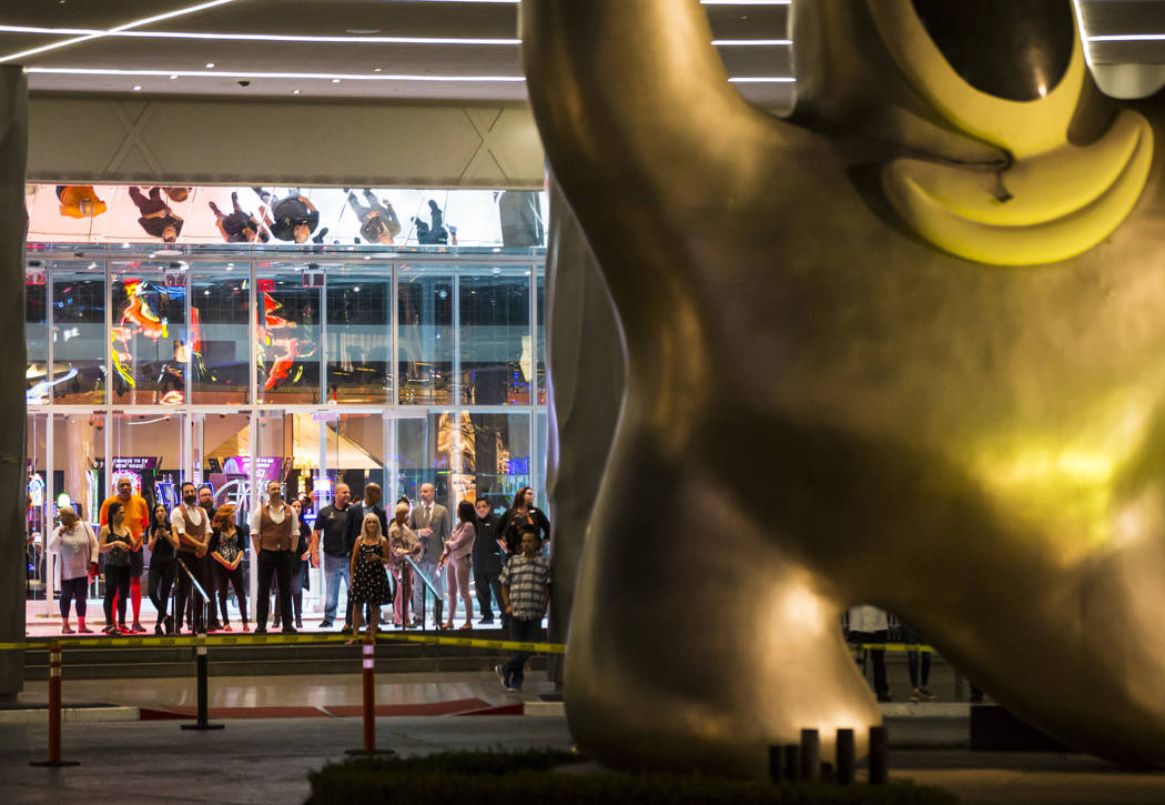 "People watch before the ""Sam by Starck"" statue at the SLS Las Vegas is demolished ahead of the ..."