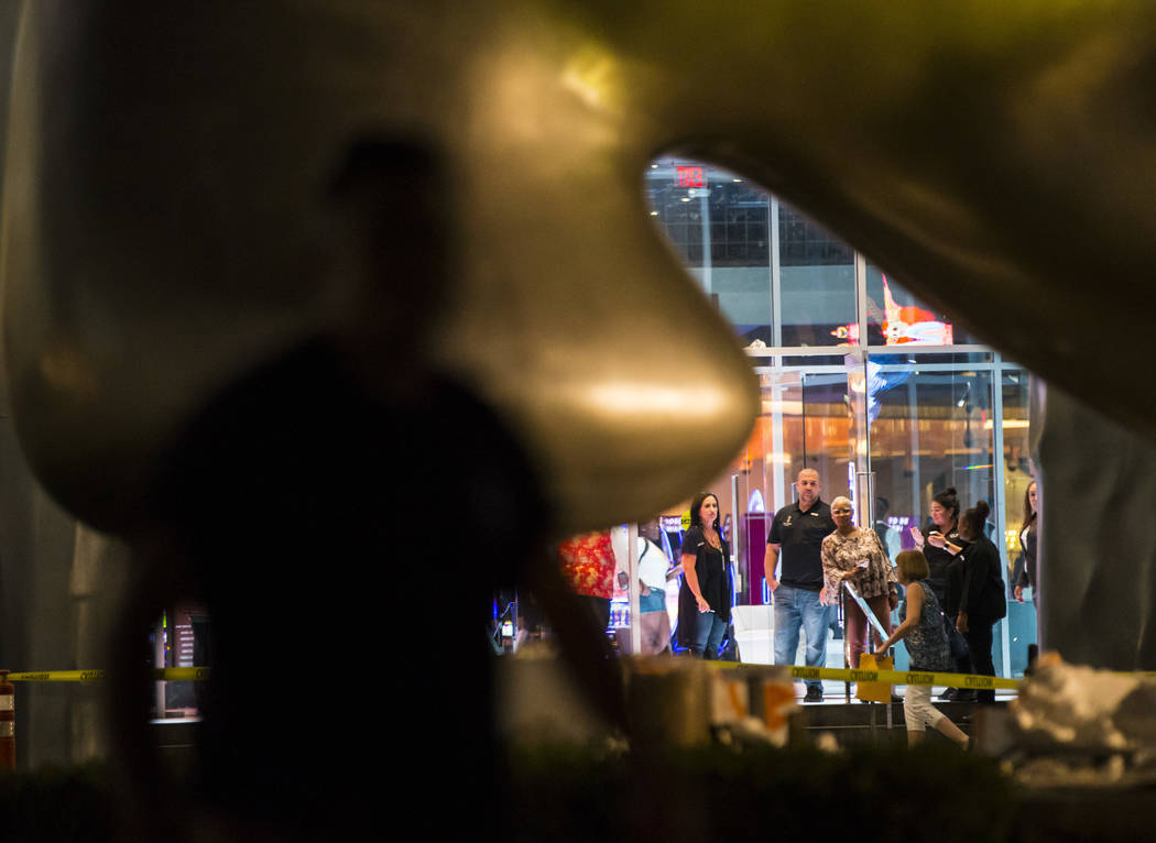 "People watch as the ""Sam by Starck"" statue at the SLS Las Vegas is demolished ahead of the reso ..."