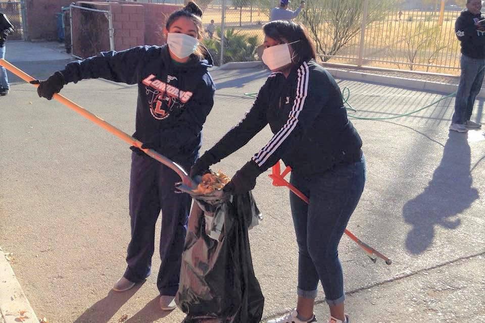Two members of Top Teens of America volunteer during a Top Ladies of Distinction community serv ...