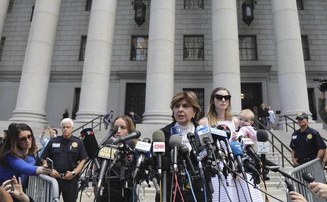 Attorney Gloria Allred, center, flanked by two of her clients, speak during a news conference a ...
