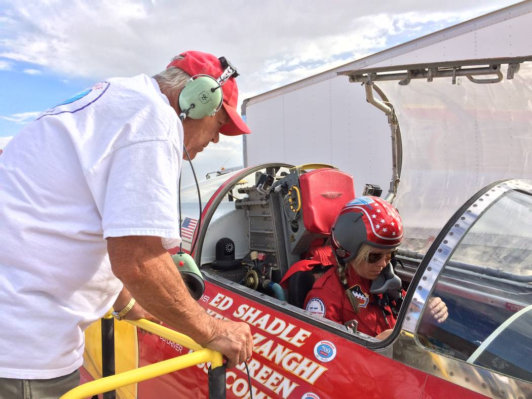 Ed Shadle looks on as driver Jessi Combs runs an engine test on the jet-powered car they hope t ...
