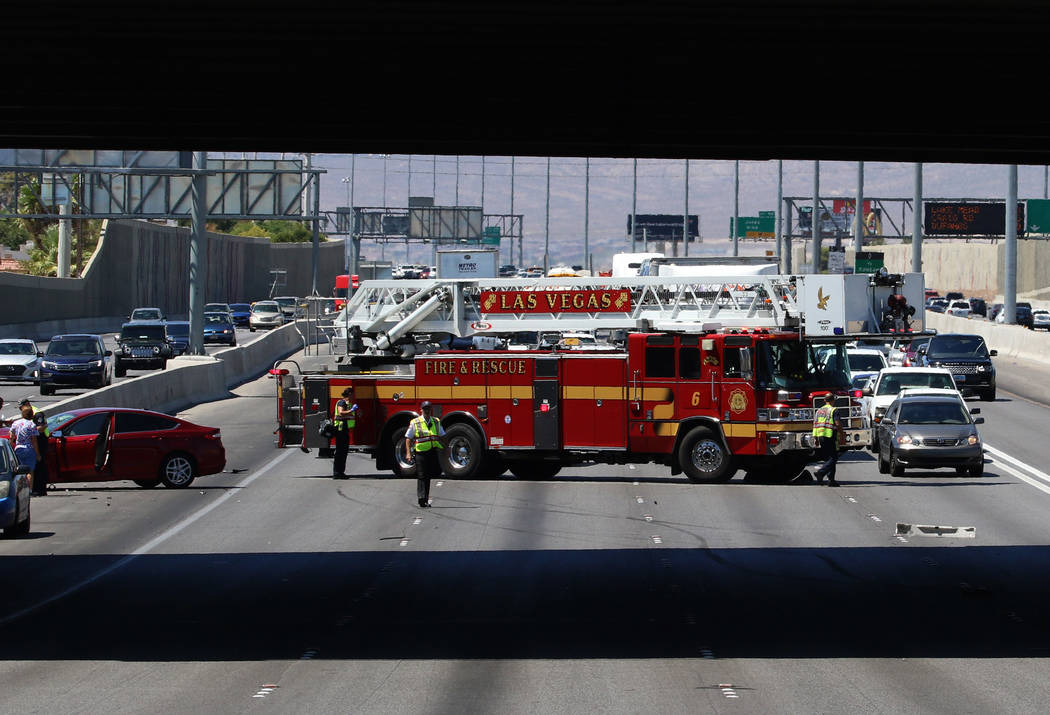Las Vegas firefighters at the scene of multi-vehicle crash at US Highway 95 southbound near Dec ...