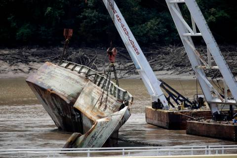 One of two sunken barges is removed from the Webbers Falls Lock and Dam 16 Tuesday, Aug. 27, 20 ...