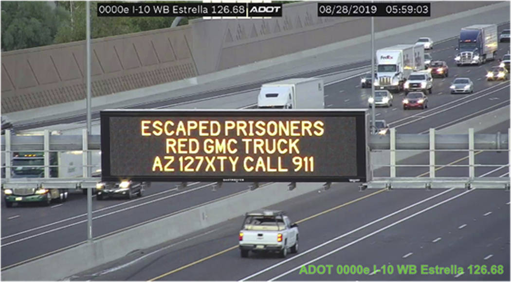 This photo from an Arizona Department of Transportation remote camera shows a digital sign ove ...