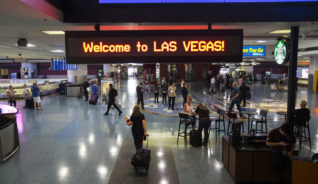 Passengers arrive at McCarran International Airport ahead of the Labor Day holiday weekend in L ...