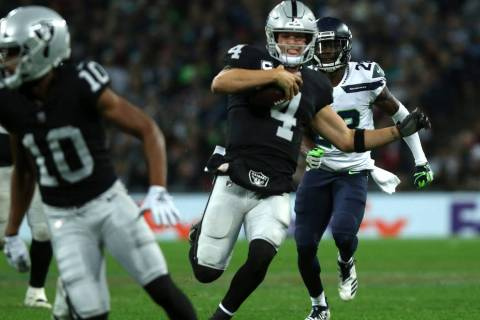 Oakland Raiders quarterback Derek Carr (4) runs with the football during the first half of an N ...