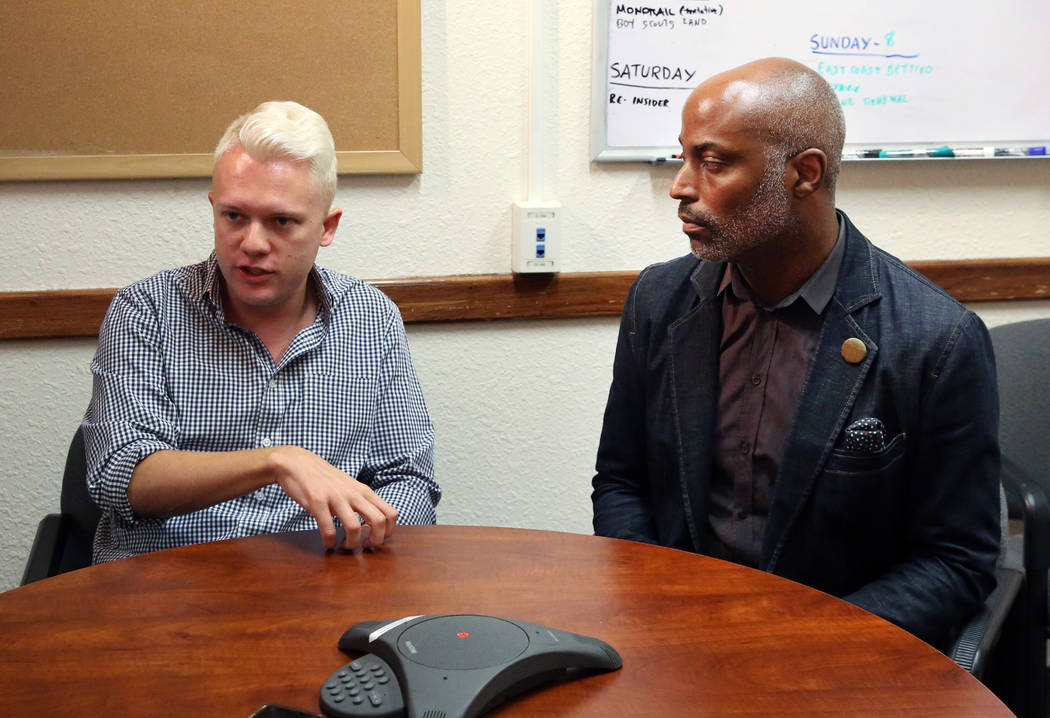 State Director of Silver State Equality, André Wade, right listens as Sam Garrett-Pate of ...