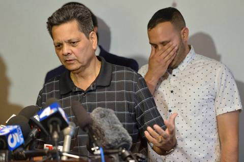 Kevin French react as his father, Russell French, describe the family's ordeal during a news co ...