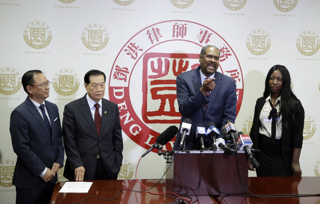 From left, attorney Daniel Deng, forensic scientist Henry Lee, attorney Brian Dunn, and Mary Es ...
