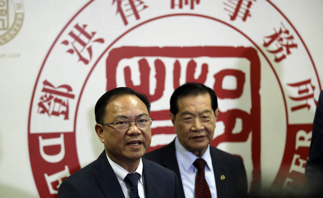 From left, attorney Daniel Deng and forensic scientist Henry Lee hold a joint news conference r ...