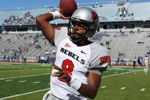 UNLV starting quarterback Caleb Herring warms up before taking on UNR at Mackay Stadium in Reno ...