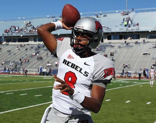 UNLV starting quarterback Caleb Herring warms up before taking on UNR at Mackay Stadium in Reno ...