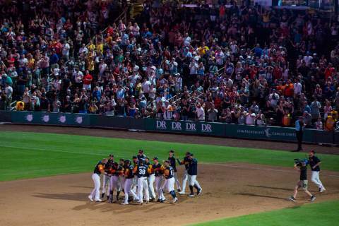 The Las Vegas Aviators celebrate their 3-2 walk-off win over the Reno Aces at the Las Vegas Bal ...