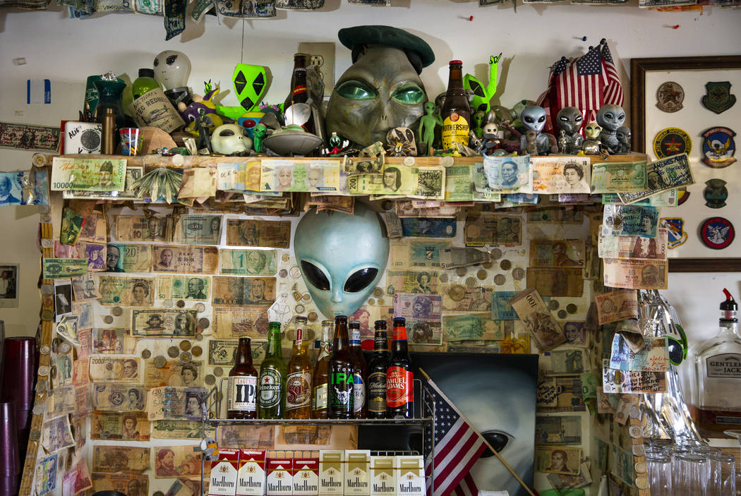 Alien memorabilia behind the bar and the restaurant at the Little A'Le'Inn in Rachel, which wil ...