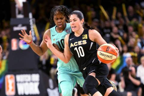 Las Vegas Aces guard Kelsey Plum (10) drives past New York Liberty guard Epiphanny Prince (10) ...
